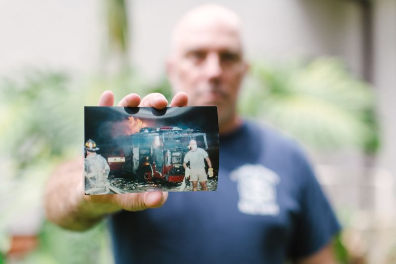 Dan shares a photo of himself working at Ground Zero. He arrived to the scene on his day off, wearing a t-shirt and shorts